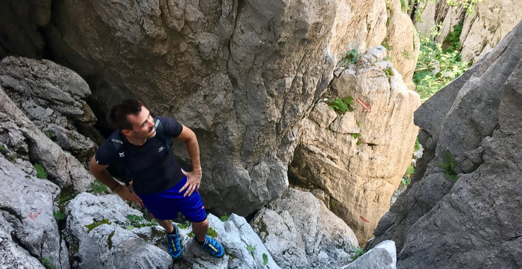 Hiker at the crux of the Veliki Kanjon, Samarske Stijene.